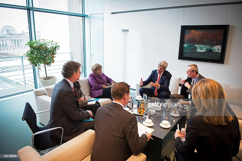 German Chancellor Angela Merkel, U.S. Secretary of State John Kerry (C), U.S. Ambassador Philip Murphy (R), Foreign Policy Adviser to the Chancellor Christoph Heusgen (L) and Government Spokesman Steffen Seibert (front) are seen during the beginning of their meeting, in the Chancellery on February 26, 2013 in Berlin, Germany. Kerry is in Germany on his first visit abroad as secretary of state, on an 11-day trip that will also take in Paris, Rome, Ankara, Cairo, Riyadh, Abu Dhabi and Doha, before he returns to the United States on March 6. Kerry spent yesterday in London, holding talks with Prime Minister David Cameron and Foreign Secretary William Hague.