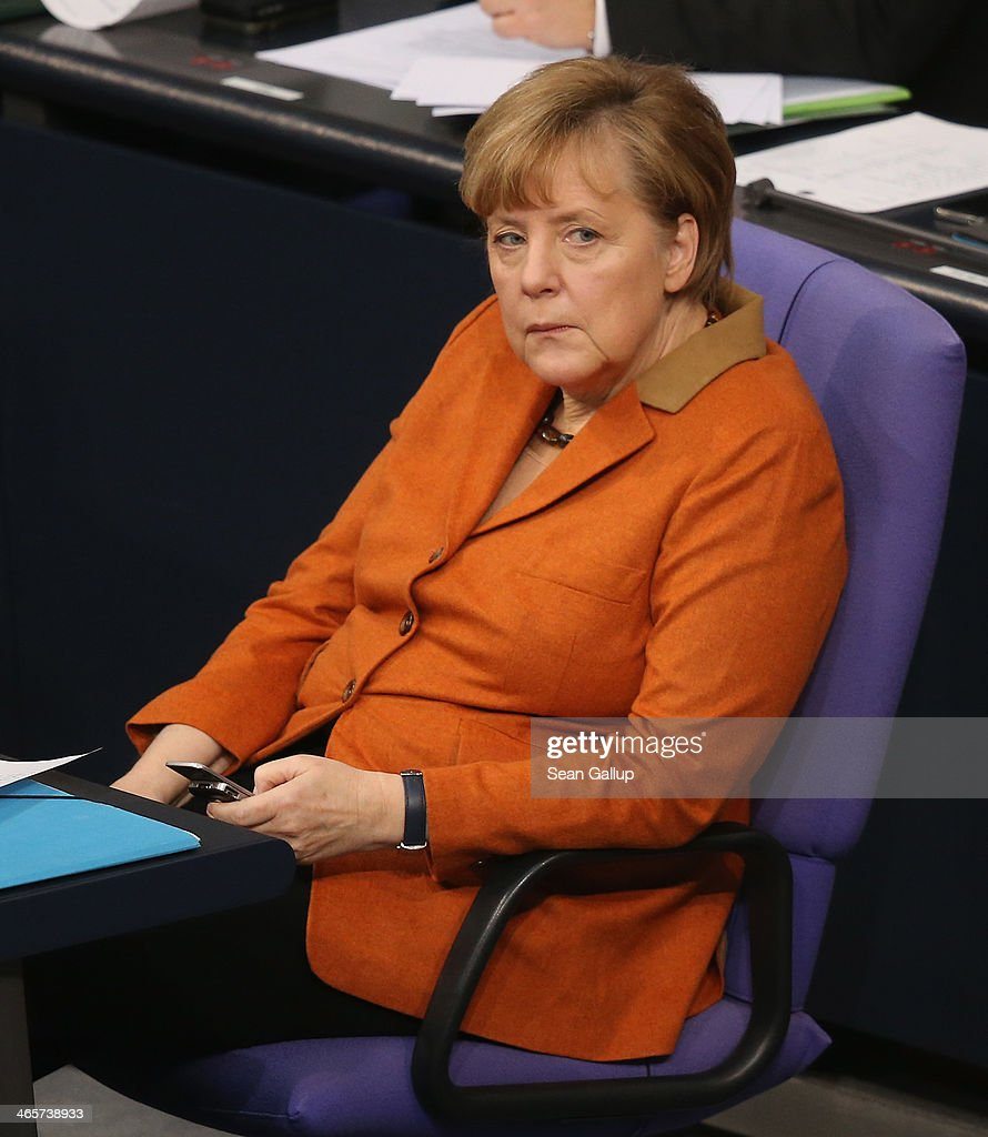 German Chancellor Angela Merkel uses a smartphone during debates at the Bundestag after she gave a government declaration to outline the policy priorities of the new German coalition government of Christian Democrats and Social Democrats on January 29, 2104 in Berlin, Germany. Revelations by Edward Snowden in 2013 that the U.S. National Security Agency (NSA) had eavesdropped on Merkel's phone caused a scandal and rift between German and U.S. relations that is still being echoed in current political debates.