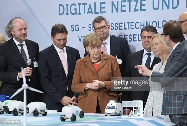 German Chancellor Angela Merkel Vice Chancellor and Economy and Energy Minister Sigmar Gabriel Education Minister Johanna Wanka look at a...