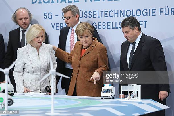 German Chancellor Angela Merkel Vice Chancellor and Economy and Energy Minister Sigmar Gabriel and Education Minister Johanna Wanka look at a...