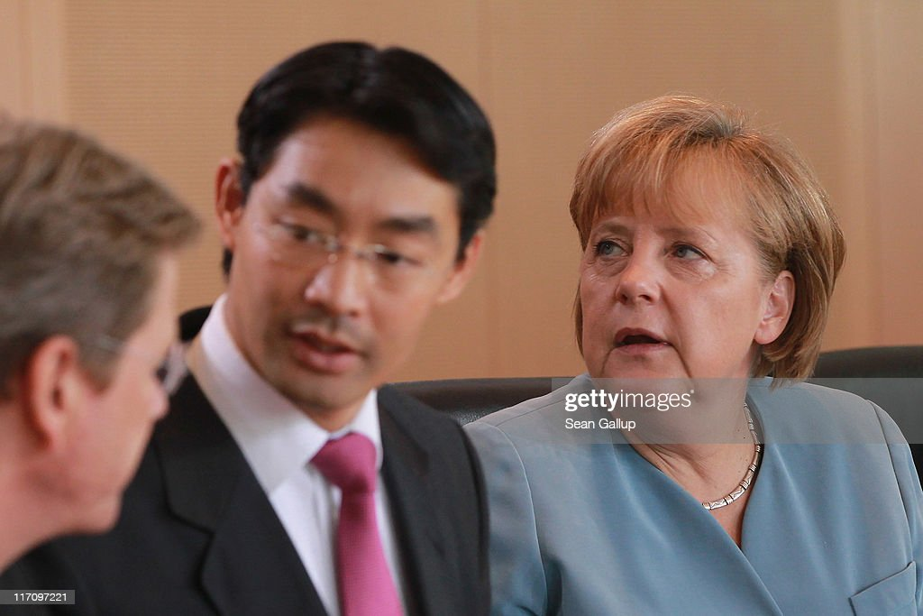German Chancellor <a gi-track='captionPersonalityLinkClicked' href=/galleries/search?phrase=Angela+Merkel&family=editorial&specificpeople=202161 ng-click='$event.stopPropagation()'>Angela Merkel</a>, Vice Chancellor and Economy Minister <a gi-track='captionPersonalityLinkClicked' href=/galleries/search?phrase=Philipp+Roesler&family=editorial&specificpeople=4838791 ng-click='$event.stopPropagation()'>Philipp Roesler</a> (C) and Foreign Minister <a gi-track='captionPersonalityLinkClicked' href=/galleries/search?phrase=Guido+Westerwelle&family=editorial&specificpeople=208748 ng-click='$event.stopPropagation()'>Guido Westerwelle</a> arrive for the weekly German government cabinet meeting at the Chancellery on June 22, 2011 in Berlin, Germany. European leaders are currently seeking a solution to Greece's debt problems that are destabilizing the Euro.