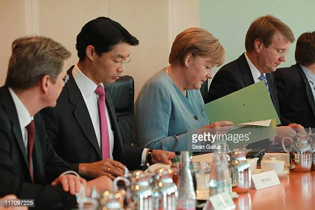 German Chancellor Angela Merkel Vice Chancellor and Economy Minister Philipp Roesler Foreign Minister Guido Westerwelle and Minister of the...