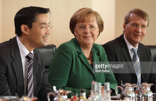 German Chancellor Angela Merkel Vice Chancellor and Economy Minister Philipp Roesler and Minister of the Chancellery Ronald Pofalla attend the weekly...