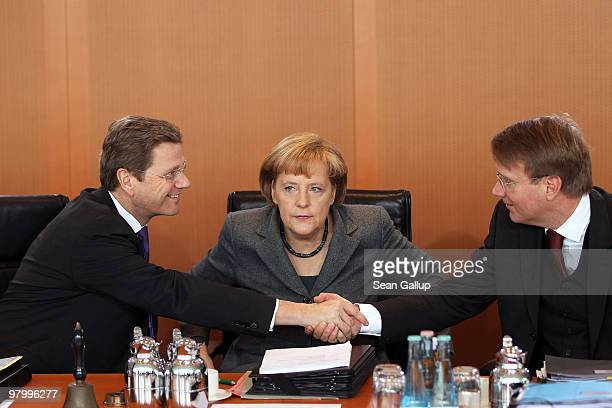 German Chancellor Angela Merkel Vice Chancellor and Foreign Minister Guido Westerwelle and Minister of the Chancellery Ronald Pofalla arrive for the...