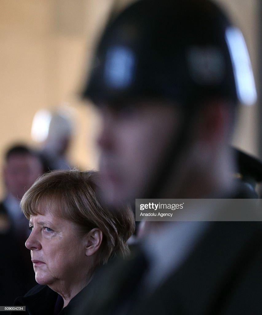 German Chancellor Angela Merkel (C) visits Anitkabir, the mausoleum of Mustafa Kemal Ataturk, founder of the Republic of Turkey, during her visit to Ankara, Turkey on February 8, 2016.