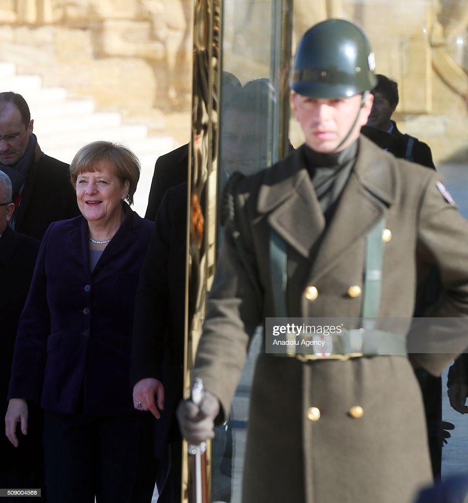German Chancellor Angela Merkel (L) visits Anitkabir, the mausoleum of Mustafa Kemal Ataturk, founder of the Republic of Turkey, during her visit to Ankara, Turkey on February 8, 2016.