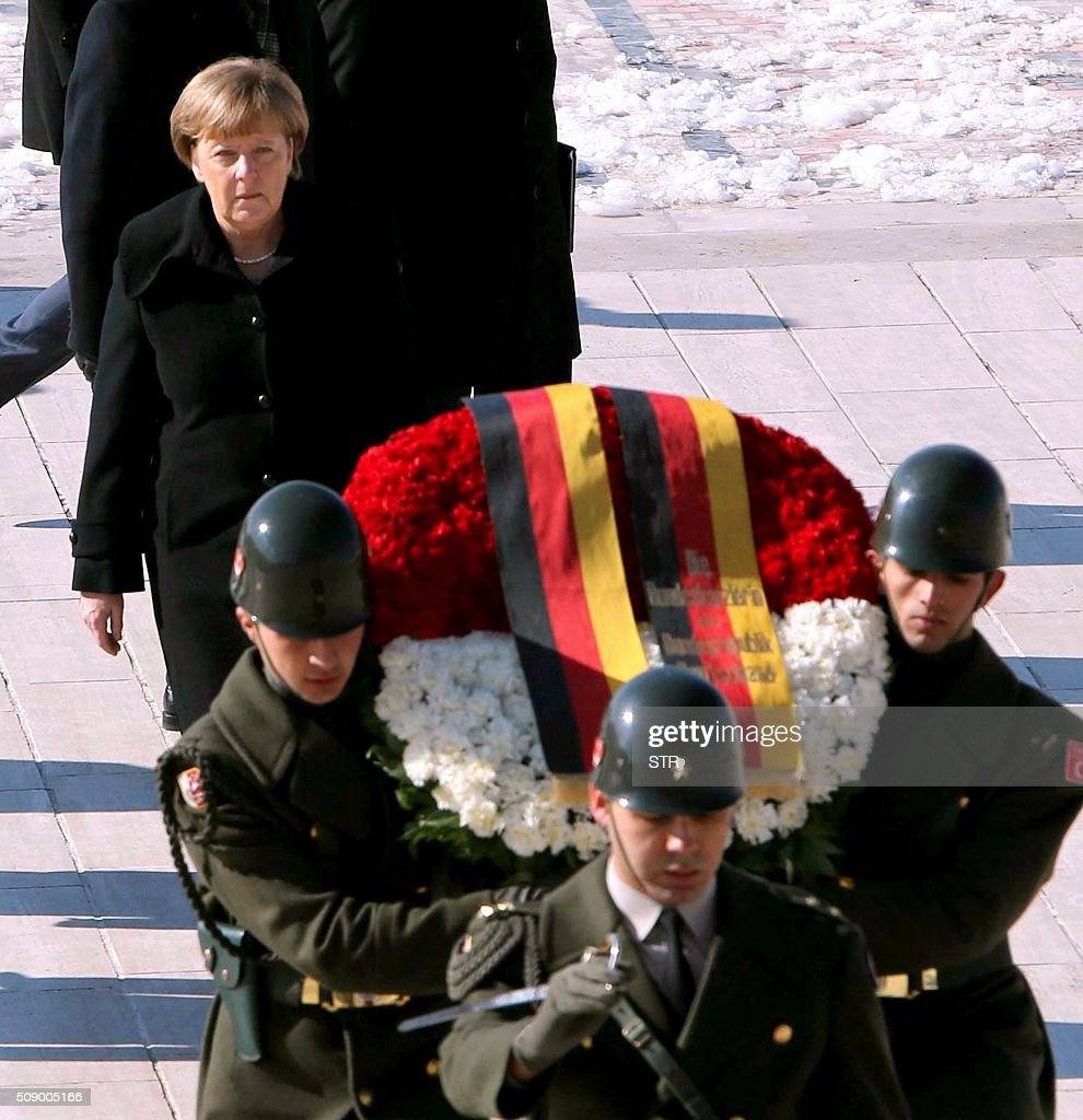 German Chancellor Angela Merkel visits Anitkabir, the mausoleum of Mustafa Kemal Ataturk, founder of the Republic of Turkey, during her visit to Ankara on February 8, 2016. Merkel is to hold talks with Turkey's President Recep Tayyip Erdogan and Prime Minister Ahmet Davutoglu to press Turkey to strengthen border controls to stem the flow of migrants and refugees heading for Europe. / AFP / STR