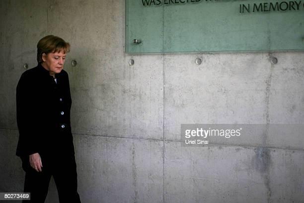 German Chancellor Angela Merkel visits the Children's Memorial at the Yad Vashem Holocaust Memorial on March 17 2008 in Jerusalem Israel Merkel is on...