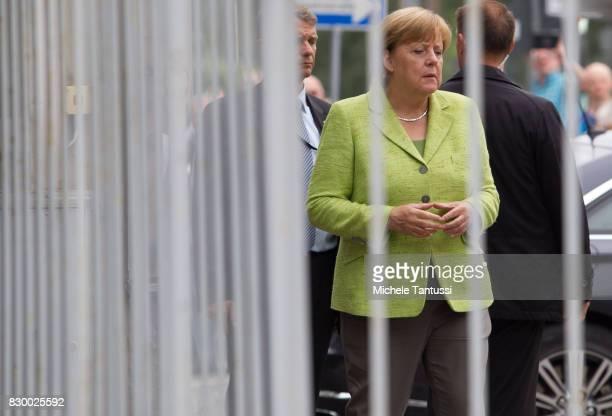 German Chancellor Angela Merkel visits the former prison of the East German communistera secret police or Stasi at Hohenschoenhausen on August 11...