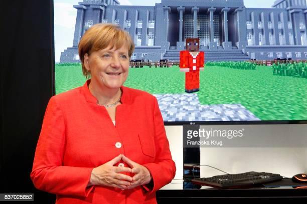 German Chancellor Angela Merkel visits the Microsoft stand during a tour through the gamescom halls at the Gamescom 2017 gaming trade fair during the...