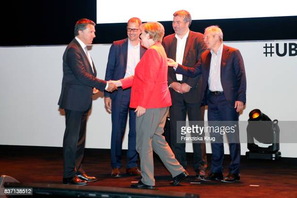 German Chancellor Angela Merkel visits the Ubisoft stand with Alain Corre Ralf Wirsing Benedikt Grindel and Yves Guillemot during a tour through the...