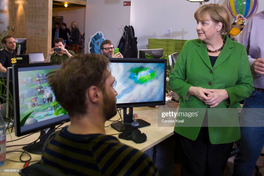 German Chancellor Angela Merkel visits the Wooga company, which makes social games for smartphones and tablets, during a tour of local startup companies on March 7, 2013 in Berlin, Germany. Berlin has drawn a significant number of startup companies in recent years, many of which are drawn by the city's hip reputation and its comparatively low cost of living.