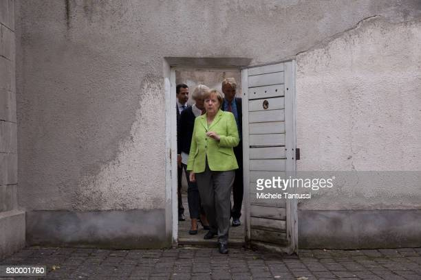 German Chancellor Angela Merkel visits with Monika Gruetters federal commissioner for Culture and Media the former prison of the East German...