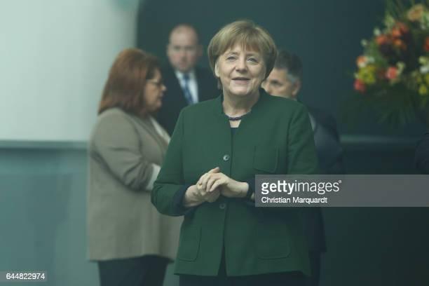 German Chancellor Angela Merkel waits behind glass inside the chancellory for arrival of EU Parliament President Antonio Tajani on February 24 2017...