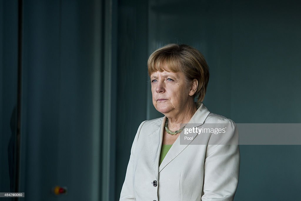 German Chancellor <a gi-track='captionPersonalityLinkClicked' href=/galleries/search?phrase=Angela+Merkel&family=editorial&specificpeople=202161 ng-click='$event.stopPropagation()'>Angela Merkel</a> waits for delegates at the German government Balkan conference at the Chancellery on August 28, 2014 in Berlin, Germany. The leaders of Albania, Kosovo, Croatia, Bosnia-Herzegovina, Slovenia, Serbia, Montenegro and Macedonia are participating in the conference that also includes Austrian Chancellor Werner Faymann and European Commission President Jose Manuel Barroso.