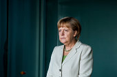German Chancellor Angela Merkel waits for delegates at the German government Balkan conference at the Chancellery on August 28 2014 in Berlin Germany...