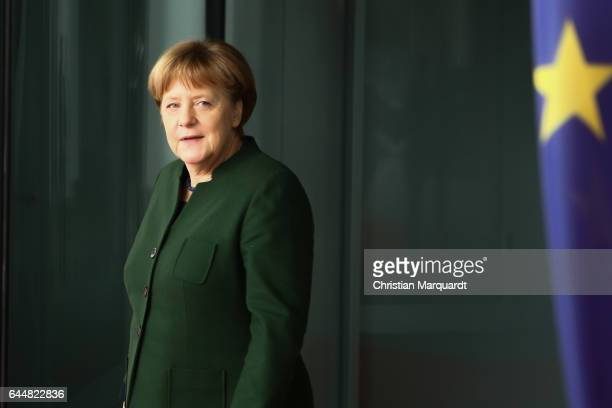 German Chancellor Angela Merkel waits for the arrival of EU Parliament President Antonio Tajani at the chancellory on February 24 2017 in Berlin...