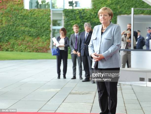 German Chancellor Angela Merkel waits for the arrival of Israeli President Reuven Rivlin ahead of their meeting in Berlin Germany on September 07 2017