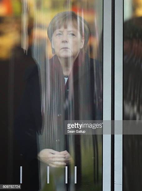German Chancellor Angela Merkel waits for the arrival of Polish Prime Minister Beata Szydlo at the Chancellery on February 12 2016 in Berlin Germany...