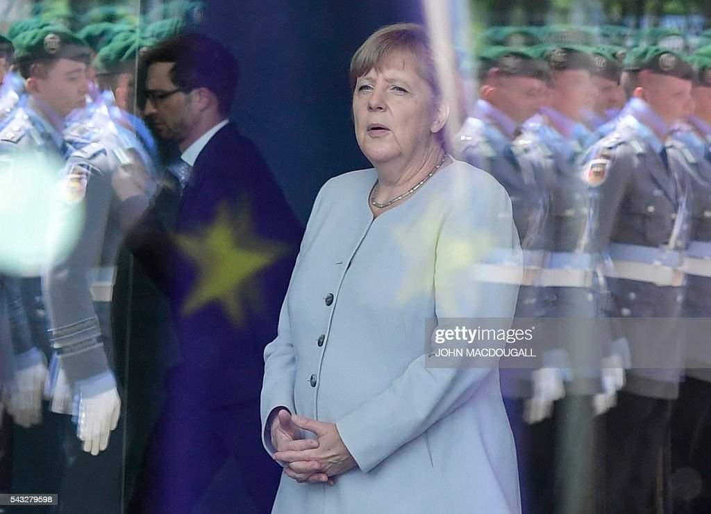 German chancellor Angela Merkel waits for the arrival of the Ukraininian Prime Minister before talks at the chancellery in Berlin on June 27, 2016. / AFP / John MACDOUGALL