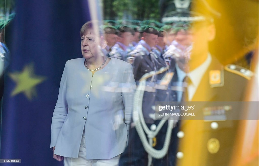 German chancellor Angela Merkel waits for the arrival of the Ukrainian Prime Minister before talks at the chancellery in Berlin on June 27, 2016. / AFP / John MACDOUGALL