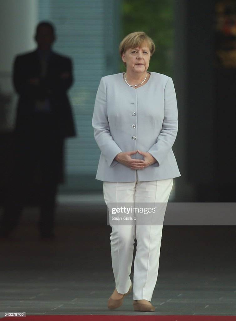 German Chancellor <a gi-track='captionPersonalityLinkClicked' href=/galleries/search?phrase=Angela+Merkel&family=editorial&specificpeople=202161 ng-click='$event.stopPropagation()'>Angela Merkel</a> waits for the arrival of Ukrainian Prime Minister Volodymyr Groysman at the Chancellery on June 27, 2016 in Berlin, Germany. Merkel is scheduled to receive French President Francois Hollande, Italian Prime Minister Matteo Renzi and European Council President Donald Tusk later today to discuss the consequences of last week's Brexit vote.