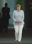 German Chancellor Angela Merkel waits for the arrival of Ukrainian Prime Minister Volodymyr Groysman at the Chancellery on June 27 2016 in Berlin...