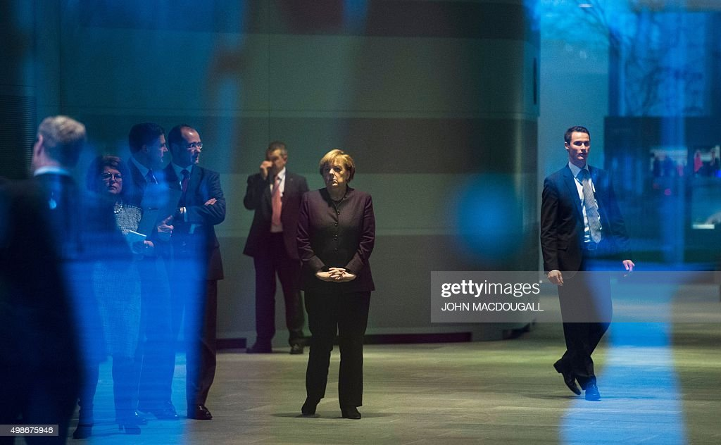 German Chancellor Angela Merkel waits for the arrivial of Vietnam's President at the chancellery in Berlin on November 25 2015 AFP PHOTO / JOHN...
