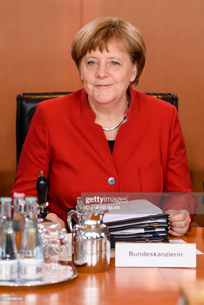 German Chancellor Angela Merkel waits for the opening of the weekly cabinet meeting at the Federal Chancellery in Berlin, on May 4, 2016. / AFP / CLEMENS