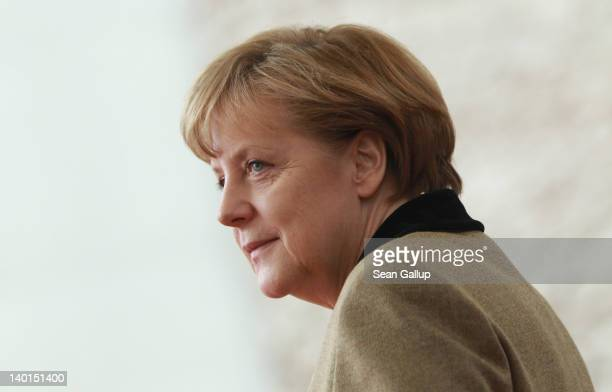 German Chancellor Angela Merkel waits to greet General Sheikh Mohammed bin Zayed Al Nahyan the Crown Prince of Abu Dhabi at the Chancellery on...