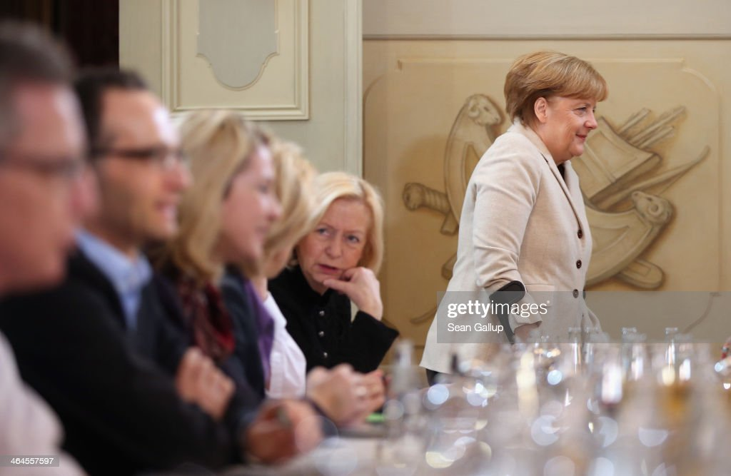 German Chancellor <a gi-track='captionPersonalityLinkClicked' href=/galleries/search?phrase=Angela+Merkel&family=editorial&specificpeople=202161 ng-click='$event.stopPropagation()'>Angela Merkel</a>, walking with crutches due to a cross-country skiing injury, arrives for day two of meetings of the German government cabinet as government ministers sit at the meeting table at Schloss Meseberg palace on January 23, 2014 in Meseberg, Germany. The government cabinet of Christian Democrats and Social Democrats is on a two-day retreat at Meseberg.