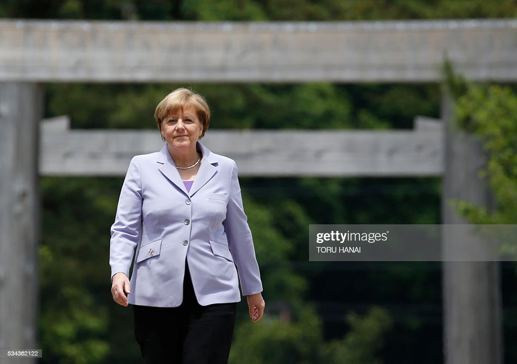 German Chancellor Angela Merkel walks across Ujibashi bridge as she visits Ise-Jingu Shrine in the city of Ise in Mie prefecture, on May 26, 2016, on the first day of the G7 leaders summit. World leaders kick off two days of G7 talks in Japan on May 26 with the creaky global economy, terrorism, refugees, China's controversial maritime claims, and a possible Brexit headlining their packed agenda. / AFP / POOL / TORU