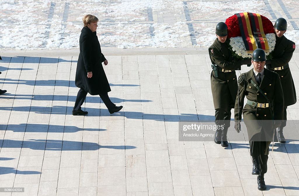 German Chancellor Angela Merkel (L) walks behind a wreath at a ceremony at Anitkabir, the mausoleum of Mustafa Kemal Ataturk, founder of the Republic of Turkey, during her visit to Ankara, Turkey on February 8, 2016.
