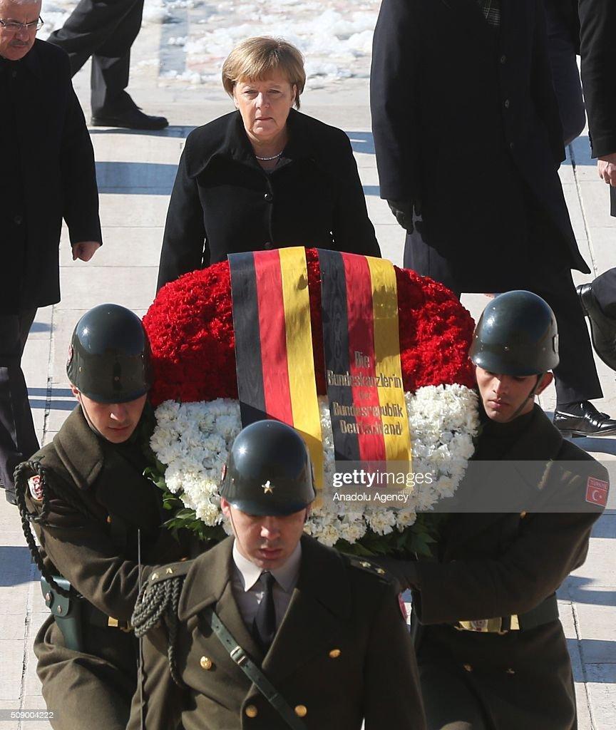 German Chancellor Angela Merkel (C) walks behind a wreath at a ceremony at Anitkabir, the mausoleum of Mustafa Kemal Ataturk, founder of the Republic of Turkey, during her visit to Ankara, Turkey on February 8, 2016.
