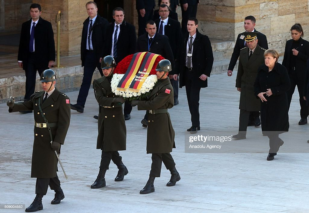 German Chancellor Angela Merkel (R) walks behind a wreath at a ceremony at Anitkabir, the mausoleum of Mustafa Kemal Ataturk, founder of the Republic of Turkey, during her visit to Ankara, Turkey on February 8, 2016.