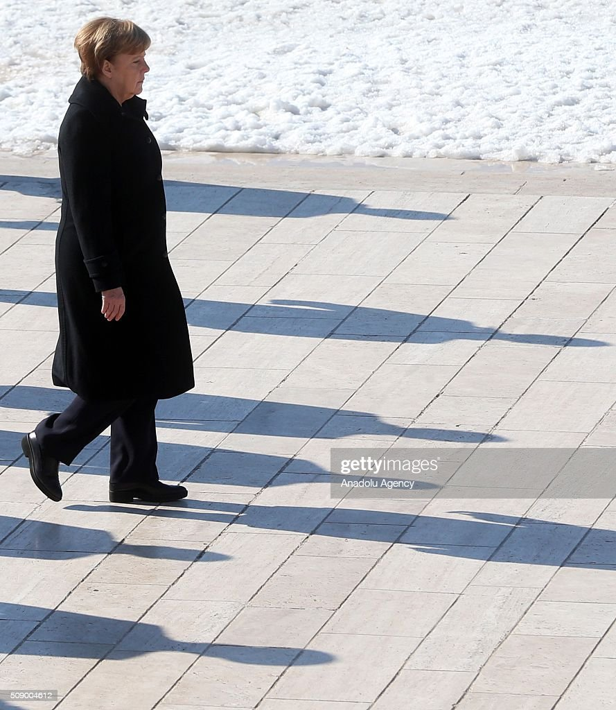 German Chancellor Angela Merkel walks behind a wreath at a ceremony at Anitkabir, the mausoleum of Mustafa Kemal Ataturk, founder of the Republic of Turkey, during her visit to Ankara, Turkey on February 8, 2016.