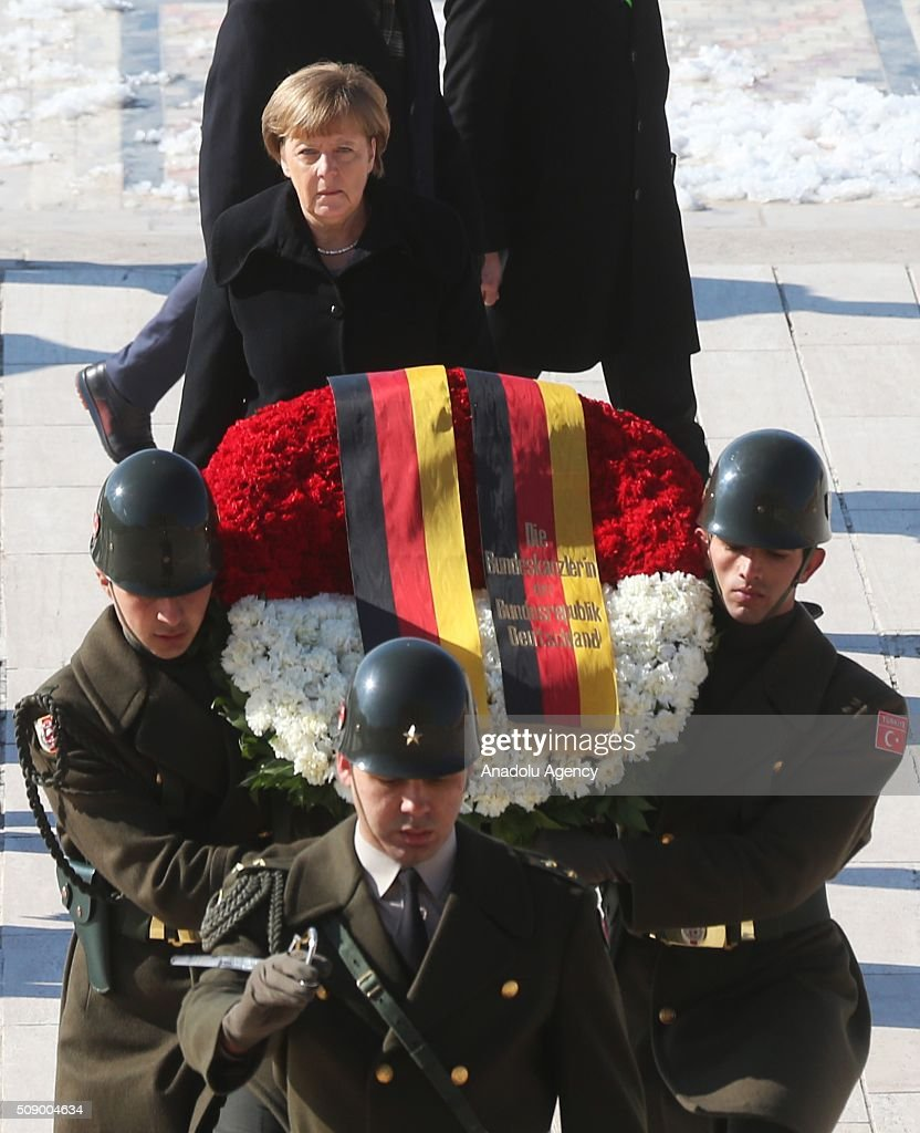 German Chancellor Angela Merkel (C) walks behind a wreath at a ceremony at Anitkabir, the mausoleum of Mustafa Kemal Ataturk, founder of the Republic of Turkey, during her visit to Ankara, Turkey on February 8, 2016.