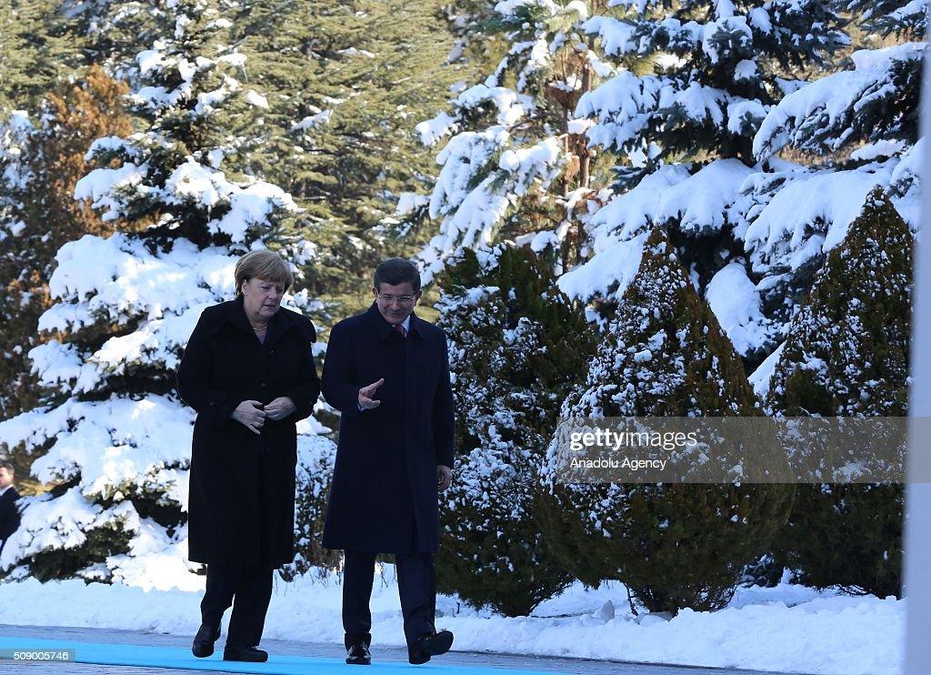 German Chancellor Angela Merkel walks near Prime Minister of Turkey Ahmet Davutoglu (R) during the official welcoming ceremony in Ankara, Turkey on February 8, 2016.