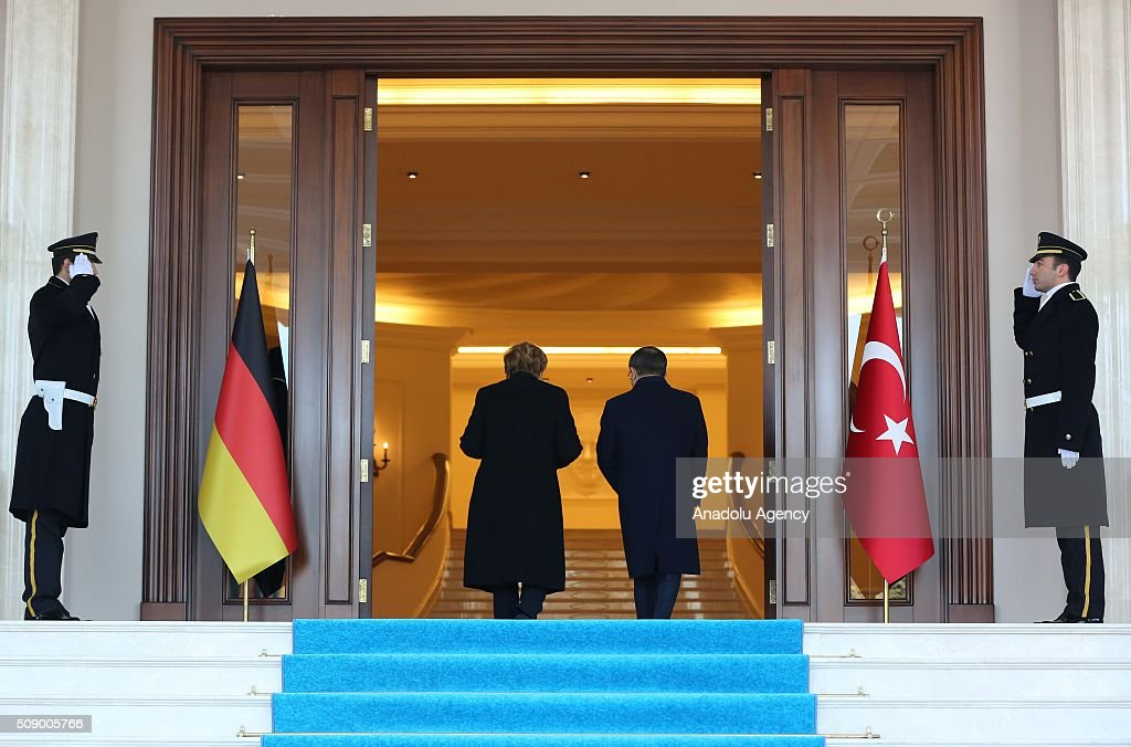German Chancellor Angela Merkel walks near Prime Minister of Turkey Ahmet Davutoglu (2ndR) during the official welcoming ceremony in Ankara, Turkey on February 8, 2016.