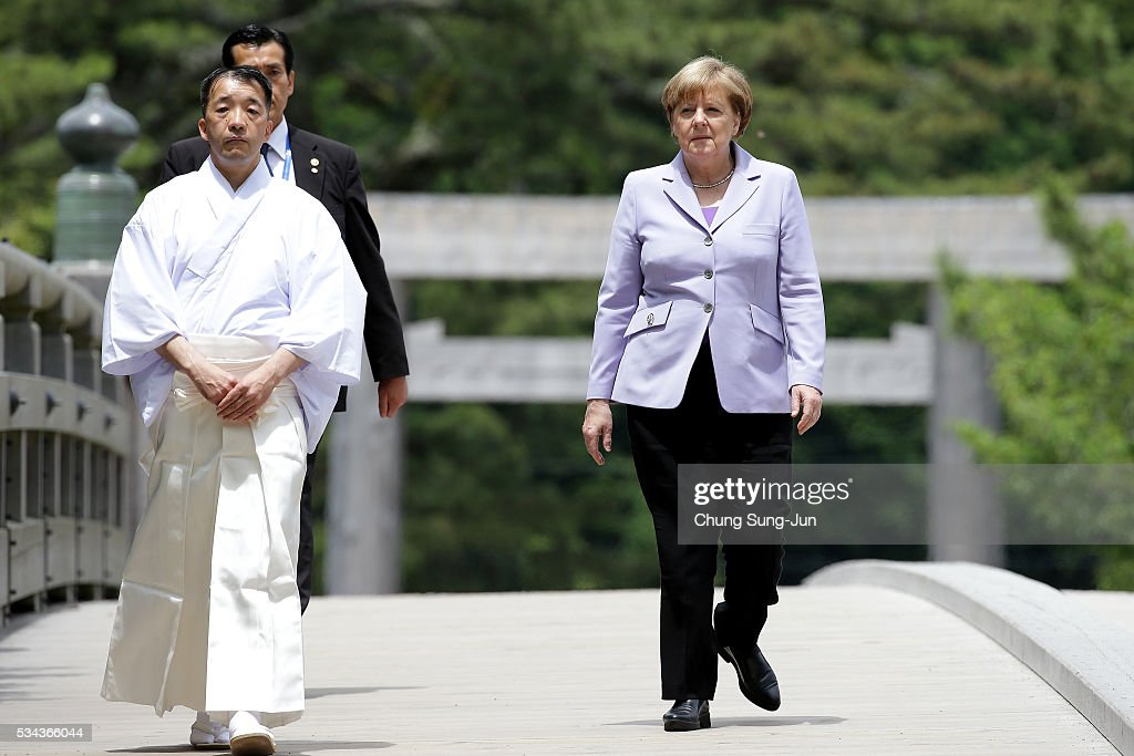 German Chancellor Angela Merkel walks on the Ujibashi bridge as she visits at the Ise-Jingu Shrine on May 26, 2016 in Ise, Japan. In the two-day summit, the G7 leaders are scheduled to discuss global issues including counter-terrorism, energy policy, and sustainable development.