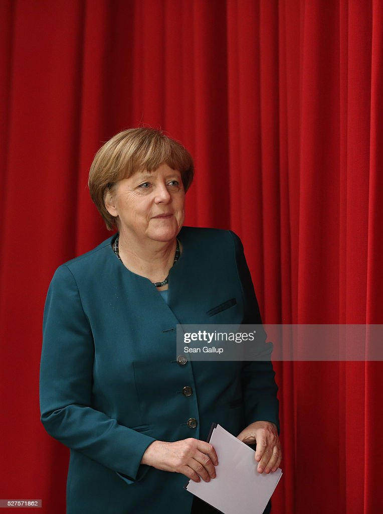 German Chancellor Angela Merkel walks onto a stage to participate in a panel discussion at the French high school (Franzoesisches Gymnasium Berlin) on May 3, 2016 in Berlin, Germany. Merkel visited the school to discuss European Union-related issues as part of the EU Project Day, in which German politicians across the country are visiting schools in order to raise awareness among high school of the role of the European Union.