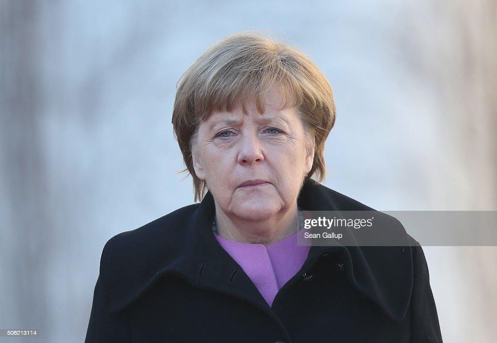 German Chancellor Angela Merkel walks together with Turkish Prime Minister Ahmet Davutoglu following Devatoglu's arrival for GermanTurkish government...