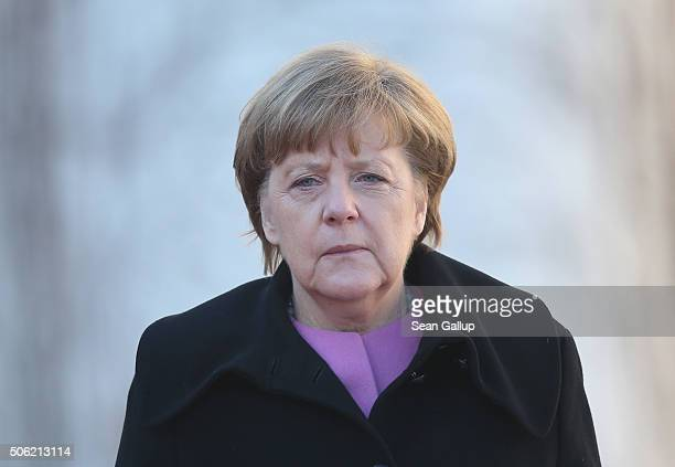 German Chancellor Angela Merkel walks together with Turkish Prime Minister Ahmet Davutoglu following Devatoglu's arrival for GermanTurkish government...