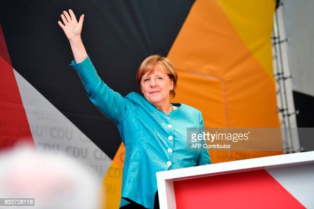German Chancellor Angela Merkel waves as she arrives to address an election campaign rally of the Christian Democratic Union in Heilbronn southern...