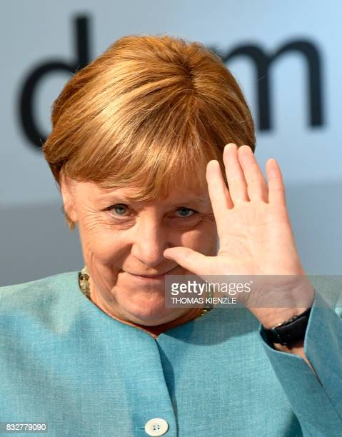 German Chancellor Angela Merkel waves during an election campaign rally of the Christian Democratic Union in Heilbronn southern Germany on August 16...