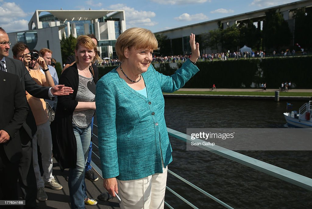 German Chancellor <a gi-track='captionPersonalityLinkClicked' href=/galleries/search?phrase=Angela+Merkel&family=editorial&specificpeople=202161 ng-click='$event.stopPropagation()'>Angela Merkel</a> waves to visitors during the annual open-house day at the Chancellery on August 25, 2013 in Berlin, Germany. Germany is facing federal elections scheduled for September 22 and so far the CDU has a substantial lead in polls over the opposition.