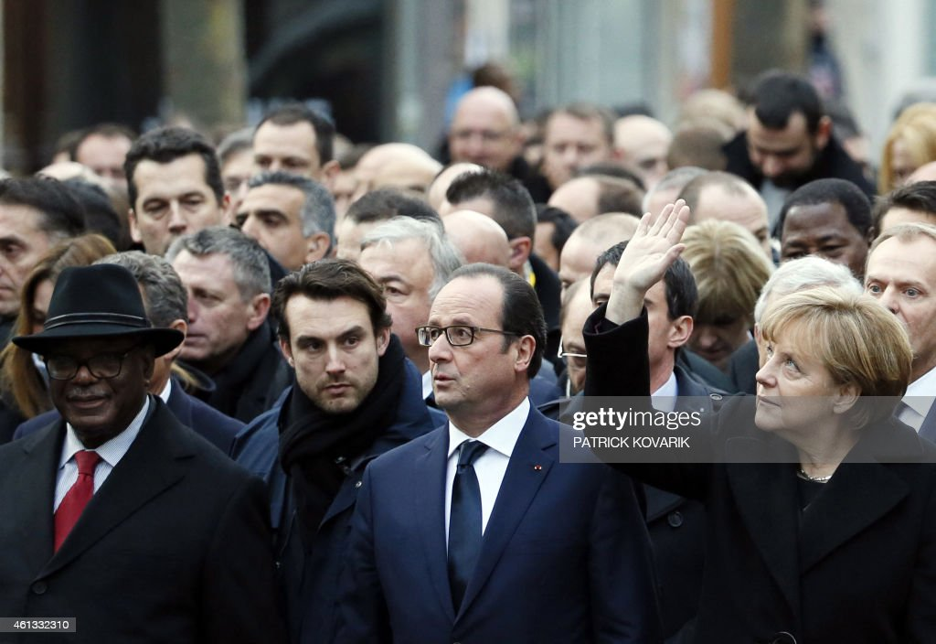 German Chancellor <a gi-track='captionPersonalityLinkClicked' href=/galleries/search?phrase=Angela+Merkel&family=editorial&specificpeople=202161 ng-click='$event.stopPropagation()'>Angela Merkel</a> (R) waves while taking part with French President Francois Hollande (2ndR) and Malian President Ibrahim Boubacar Keita (L) in a Unity rally Marche Republicaine in Paris on January 11, 2015 in tribute to the 17 victims of a three-day killing spree by homegrown Islamists. The killings began on January 7 with an assault on the Charlie Hebdo satirical magazine in Paris that saw two brothers massacre 12 people including some of the country's best-known cartoonists, the killing of a policewoman and the storming of a Jewish supermarket on the eastern fringes of the capital which killed 4 local residents.