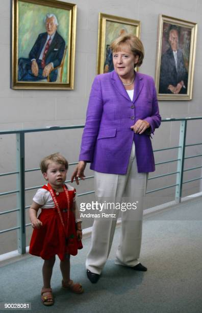 German Chancellor Angela Merkel welcomes a child at an open house day at the Chancellery on August 23 2009 in Berlin Germany Thousands of visitors...