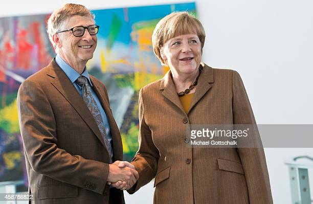 German Chancellor Angela Merkel welcomes Bill Gates Founder of Bill and Melinda Gates foundation in chancellery on November 11 2014 in Berlin Germany
