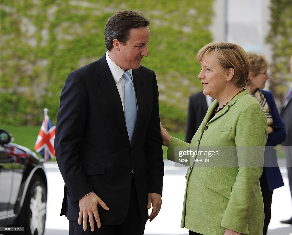 German Chancellor Angela Merkel welcomes British Prime Minister David Cameron at the Chancellery in Berlin on May 21, 2010. Cameron is on his first visit to Germany since becoming prime minister.